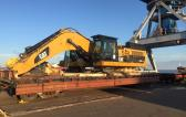CF&S Transport CAT and Komatsu Machines by Rail